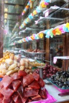 A traditional sweet shop sells candied fruits and vegetables, including potatoes!